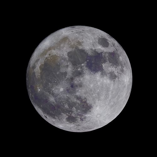 lunar craters visible on moon in dark night sky