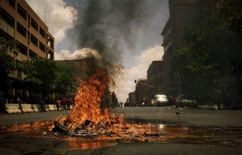 burning wreckage on empty city street